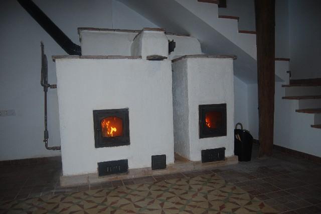 Estufas de Inercia de doble sistema de combustión. Función caldera suelo radiante.